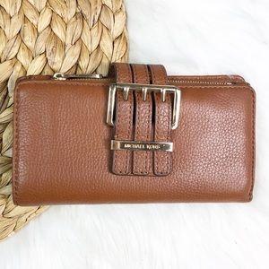 Micheal Kors Pebble Leather Buckle Zip Wallet